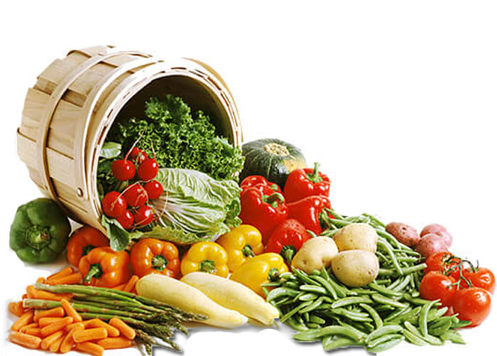 Mastella di legno che contiene frutta di stagione